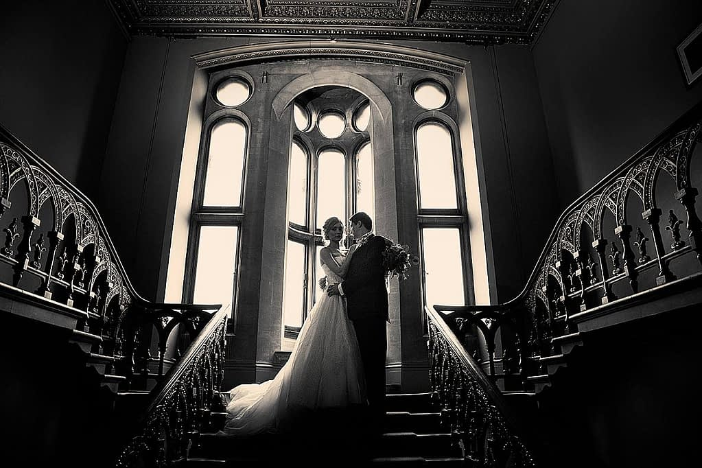Grittleton house bridal couple on staircase