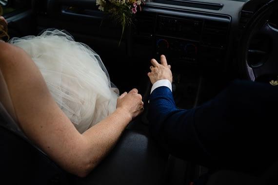 couple driving landrover micro wedding photographer