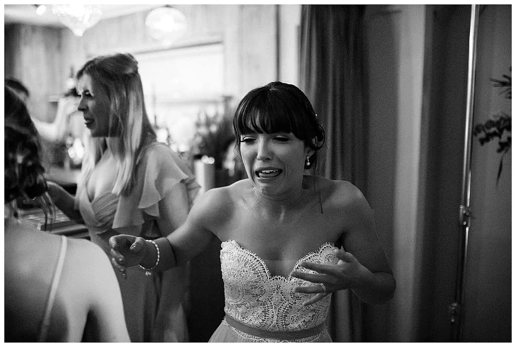 bride making face on shot frogmill cotswold wedding photographer