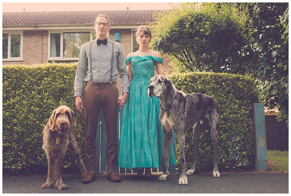 pre wedding shoot couple and standing with two great danes for a Gloucestershire wedding photographer