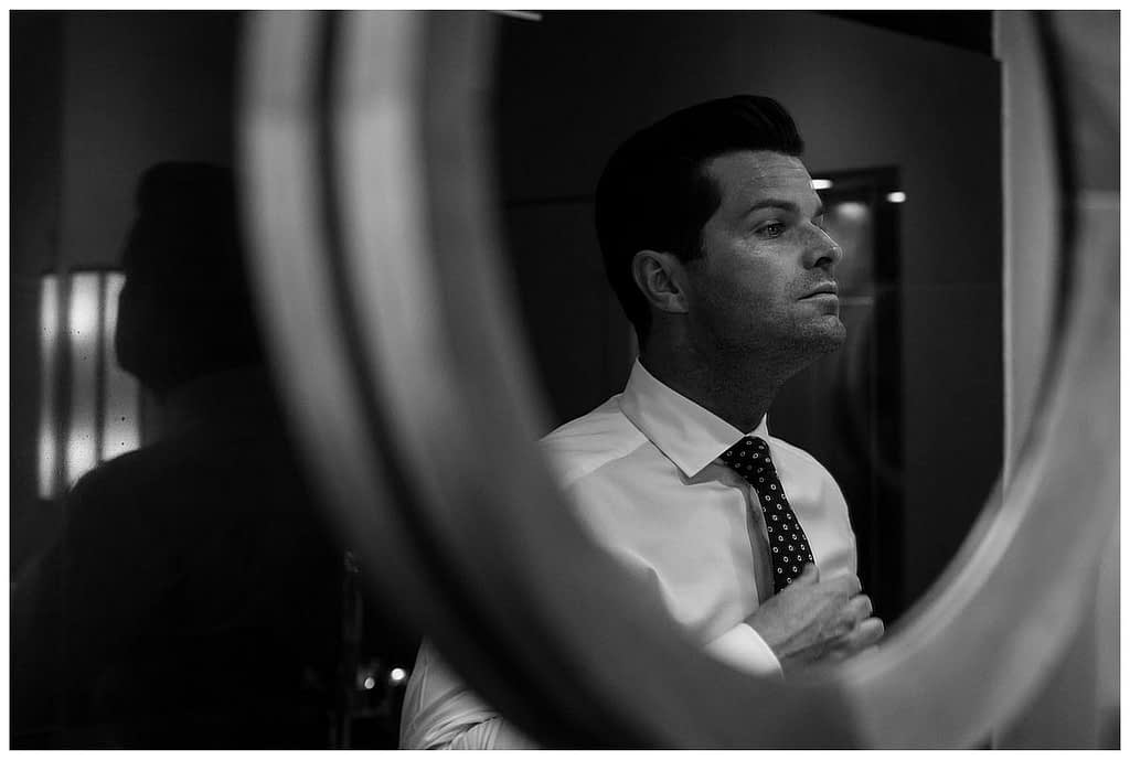 groom looking in mirror Barnsley house wedding photographer