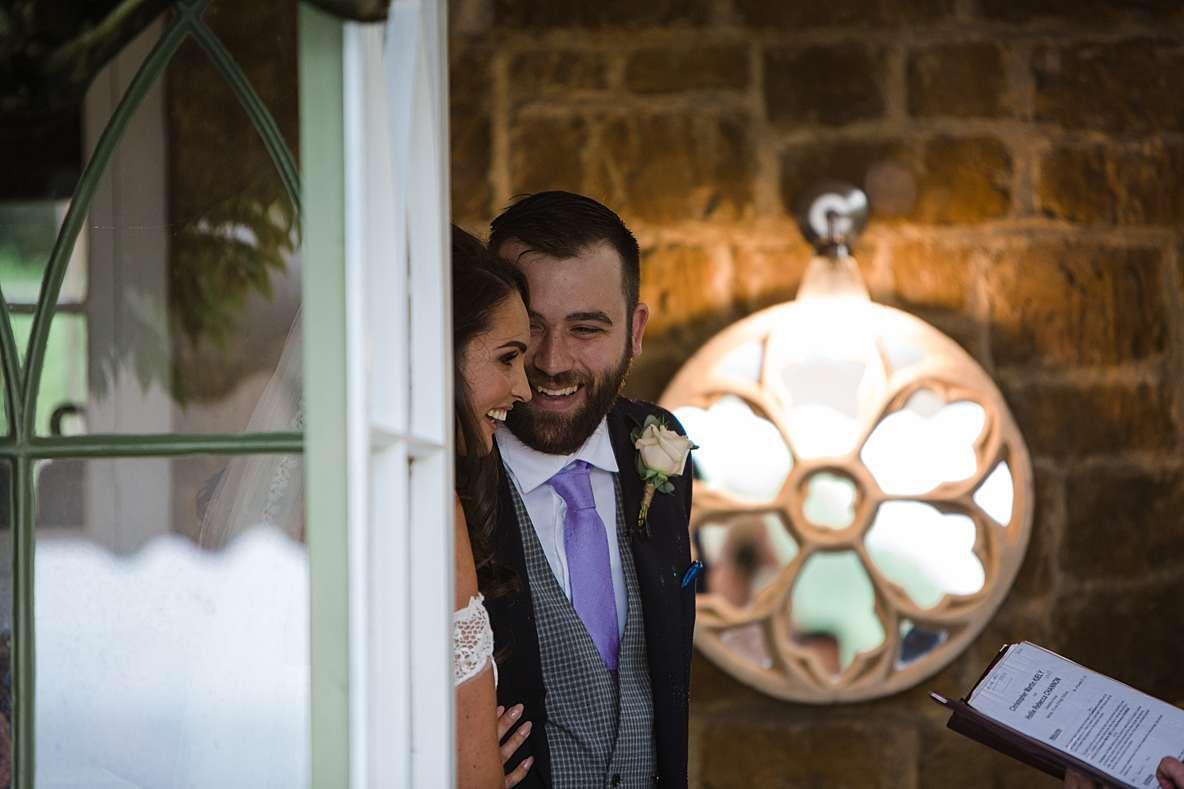 laughing couple wedding photos