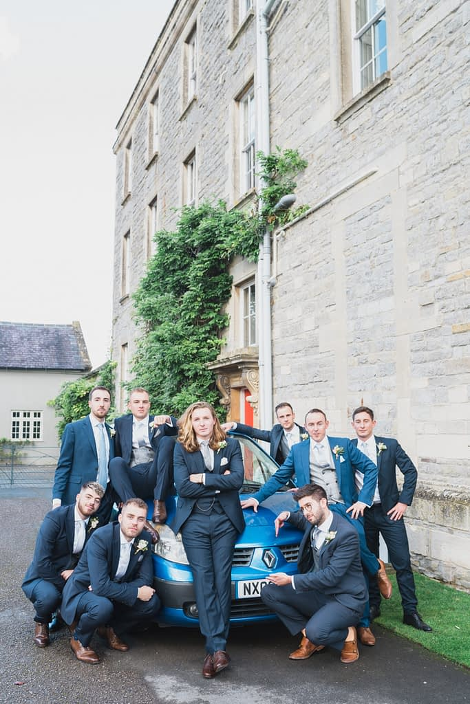 grooms party sitting on blue car Elmore court wedding photographer