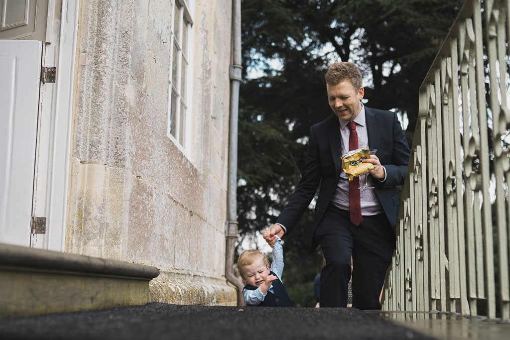 toddler walking up the stairs with dad Elmore court