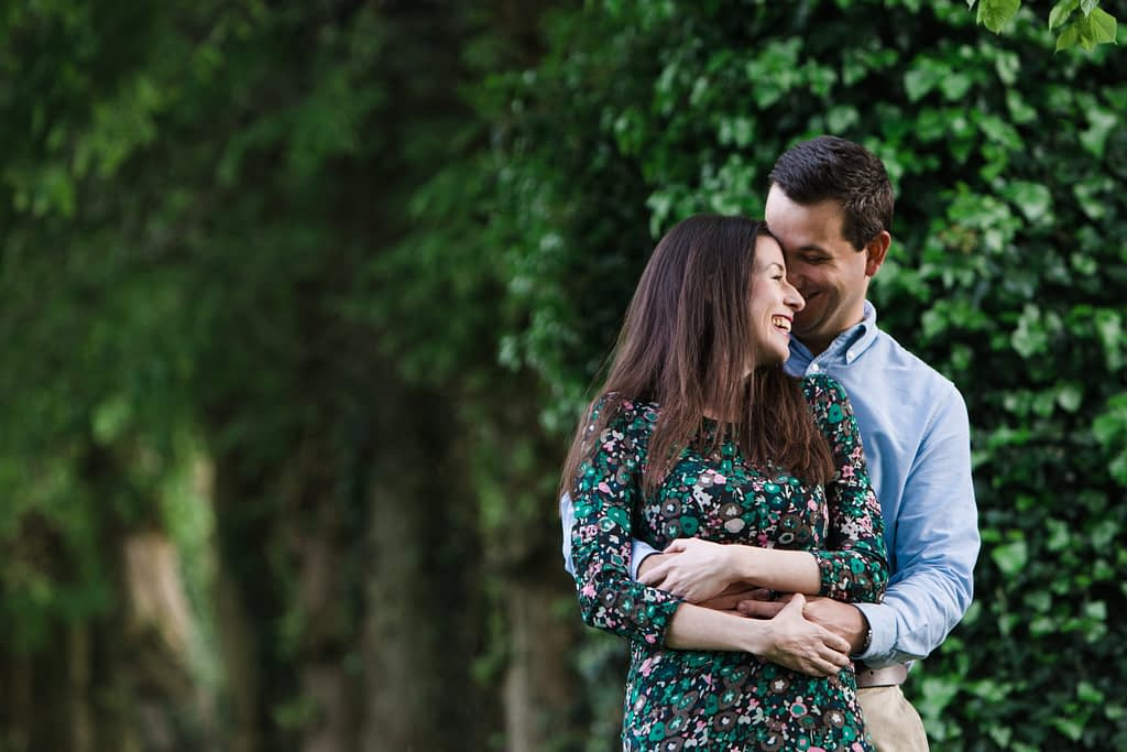 couple hugging cotswold engagement photography