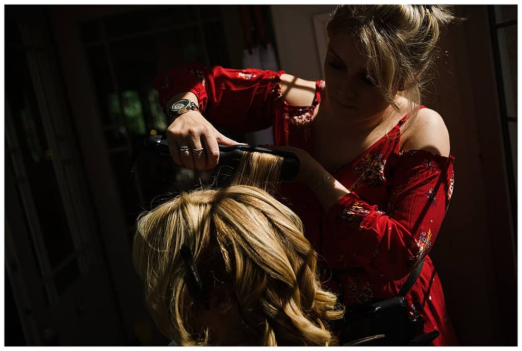 lady having hair curled Barnsley house wedding
