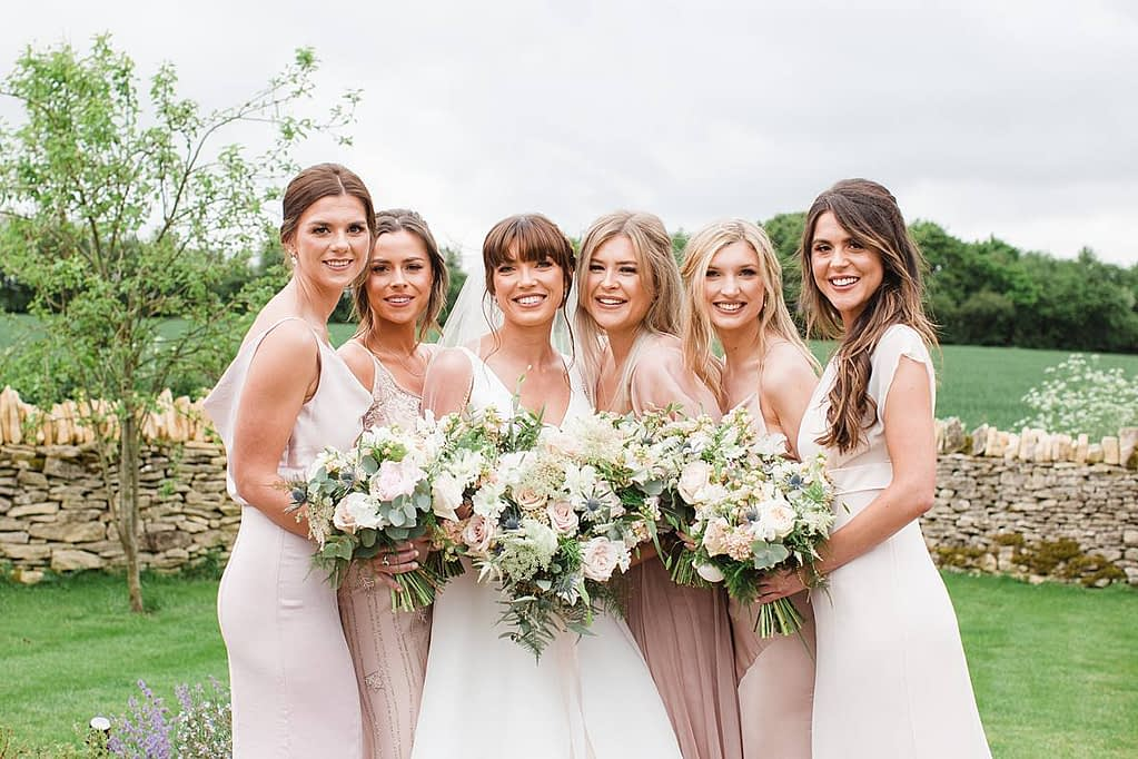 bride with bridesmaids Frogmill Inn gloucestershire wedding photographers