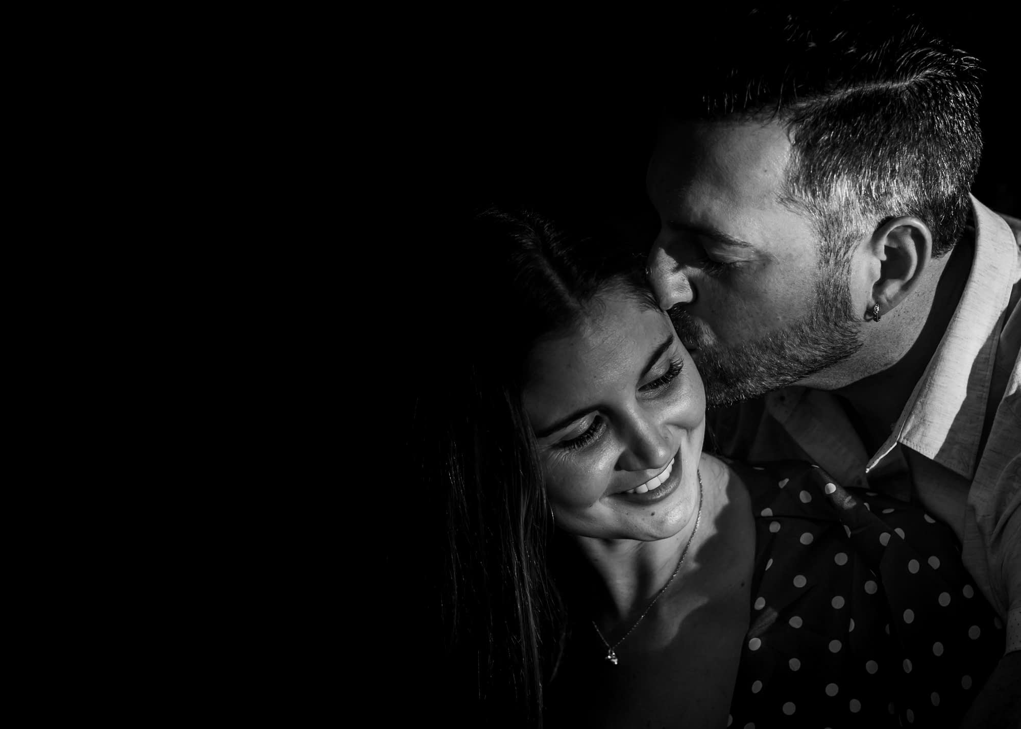 man kisses girls black and white Tortworth court gloucestershire photography