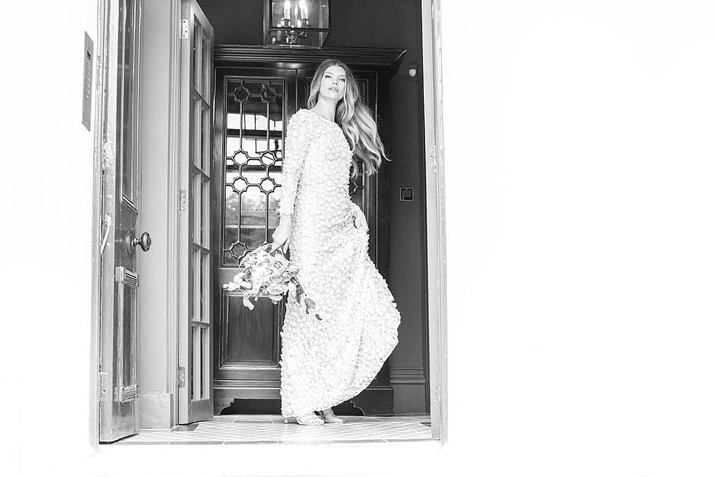 bride standing at no 131 doors wedding day