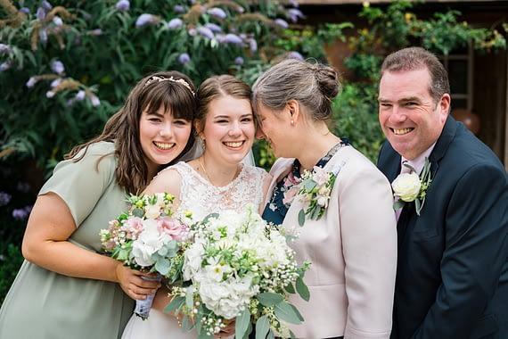 family hug micro wedding photographer gloucester
