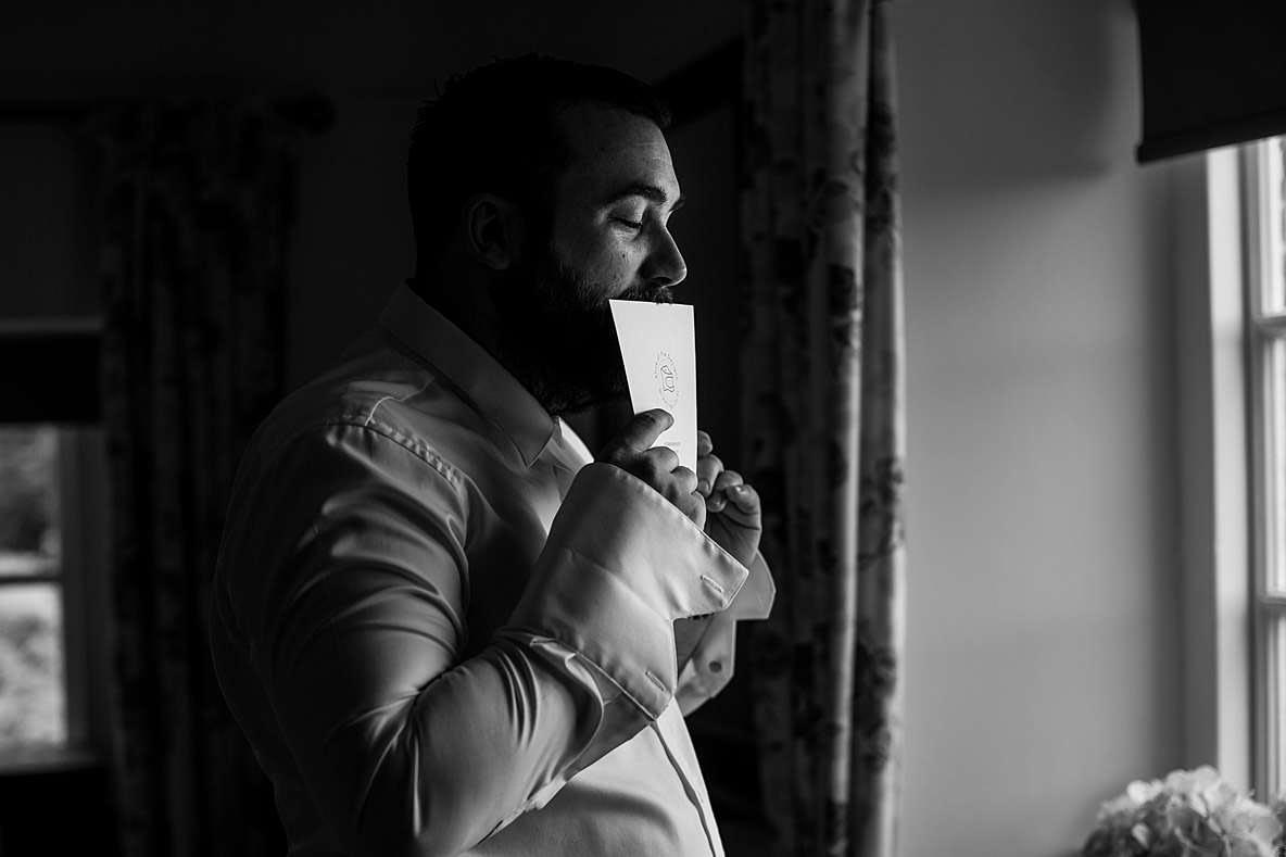 groom kissing card photographers gloucestershire