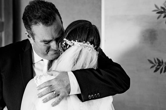 micro wedding photographer dad hugging bride