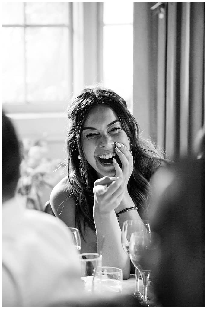 guest laughing Barnsley House wedding gloucestershire wedding photographer