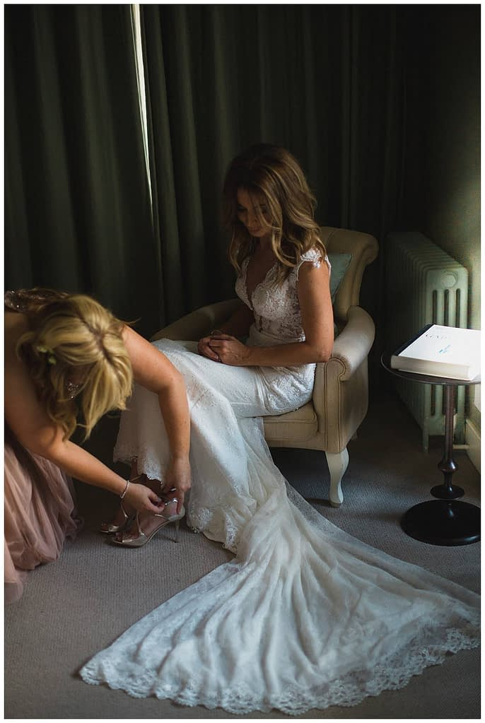 bride putting on jimmy choo shoes Barnsley house