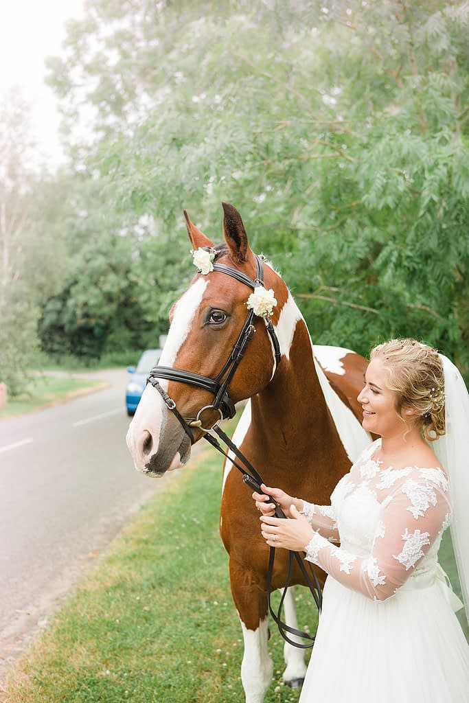 bride with horse wedding day