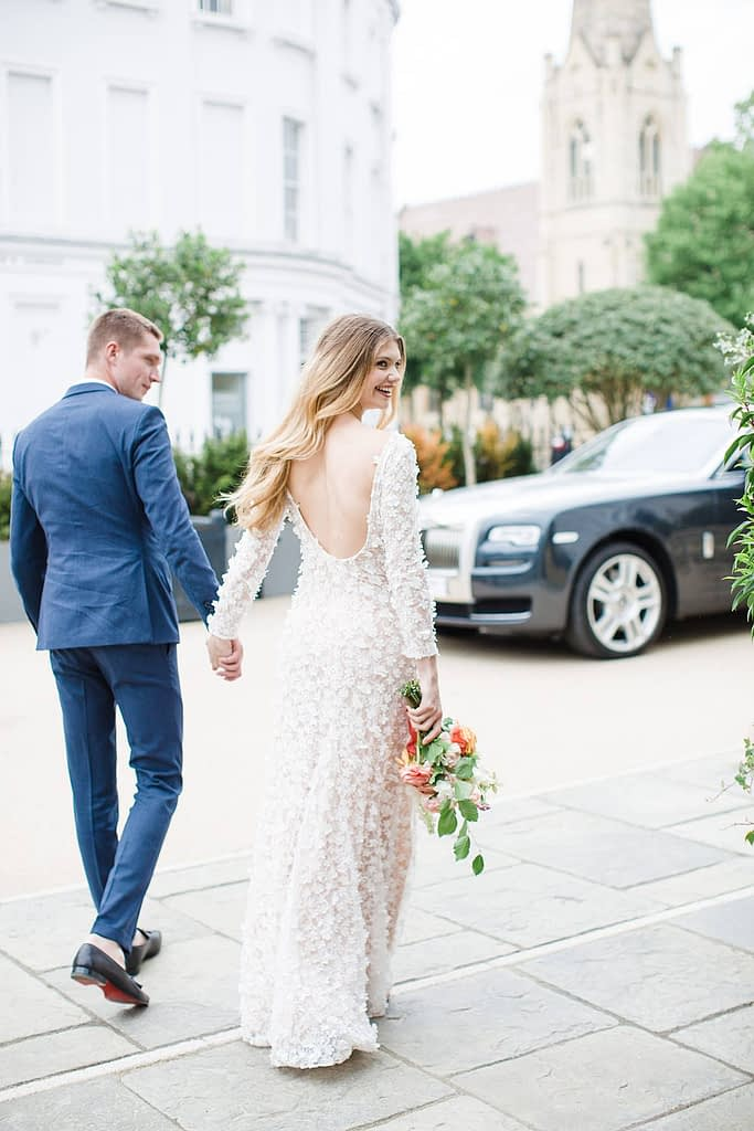 wedding couple walking no 131 outside cheltenham wedding hotel