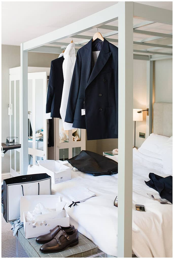 groom suit hanging in suite Barnsley house photographer