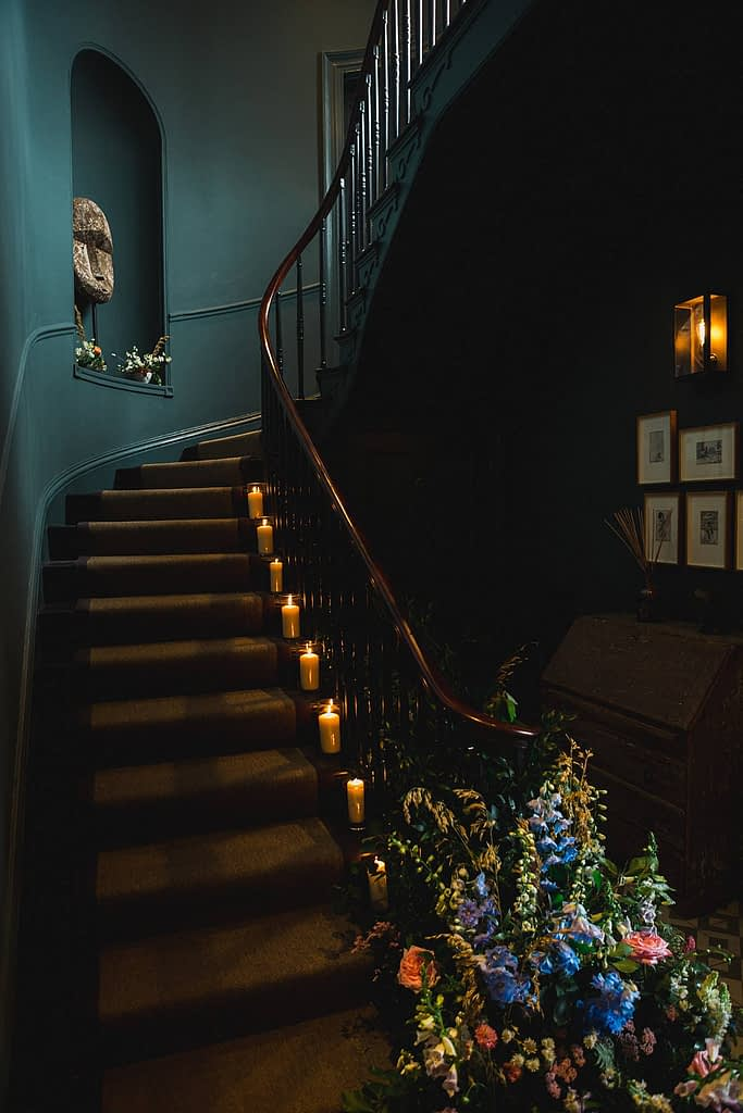 no 131 staircase with candles cheltenham wedding venue