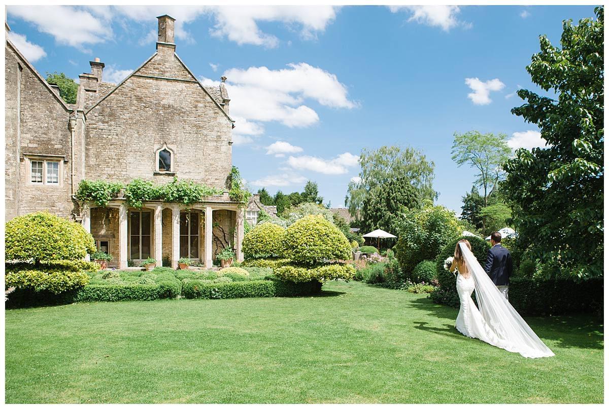 Barnsley House couple walking away from gloucestershire wedding photographer