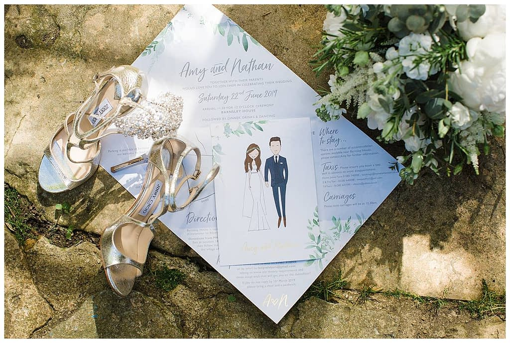 jimmy choo shoes invitation and bouquet flat lay Barnsley house wedding