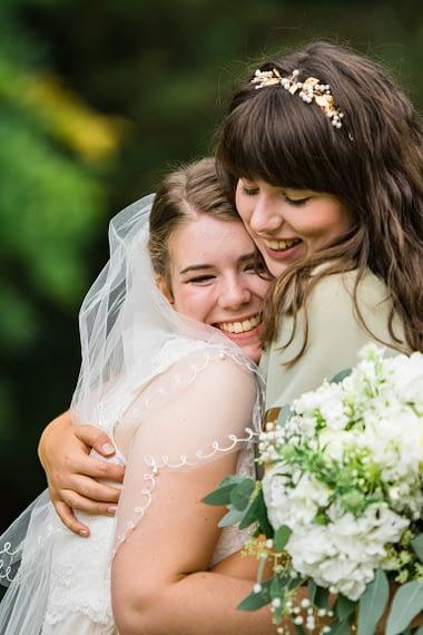 sister hug micro wedding photographer covid