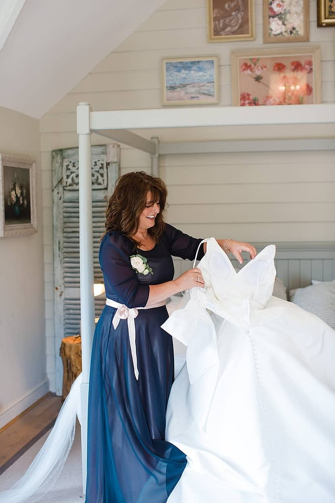 mother preparing wedding dress