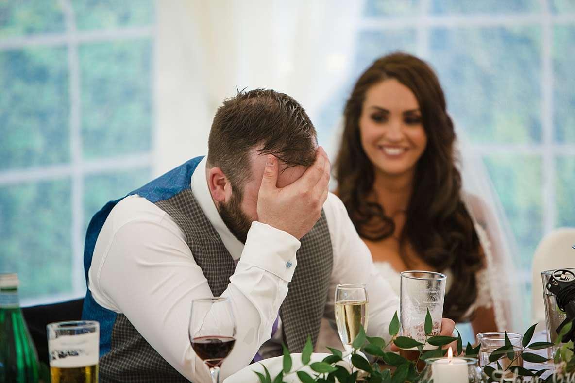 groom head in hands photographers in gloucestershire