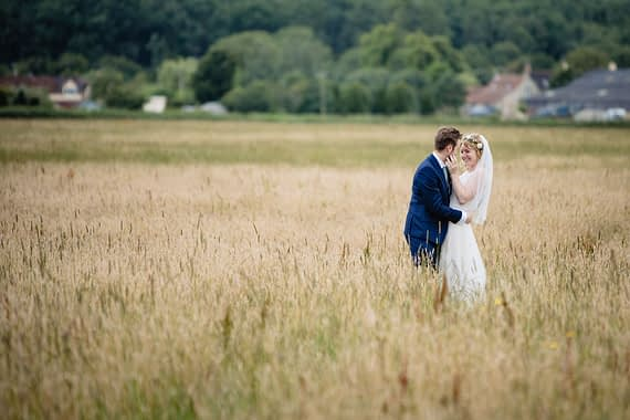 couple in field laughing micro wedding photographer